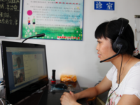 A rural patient consulting the online hospital at a sanitary station. Source: Department of Online Hospital, Guangdong Second Provincial General Hospital; Copyright: Department of Online Hospital, Guangdong Second Provincial General Hospital; URL: http://medinform.jmir.org/2018/4/e51/; License: Licensed by the authors.