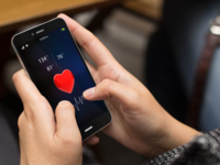 Source: Shutterstock; Copyright: Georgejmclittle; URL: https://www.shutterstock.com/image-photo/girl-using-digital-generated-phone-health-327355193?src=CFEeT_Adw4mixha9yx0bEw-1-63; License: Licensed by the authors.