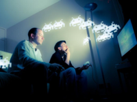 Two men playing video games. Source: Flickr; Copyright: Patrick Brosset; URL: https://www.flickr.com/photos/gnackgnackgnack/3245297998/; License: Creative Commons Attribution + Noncommercial (CC-BY-NC).
