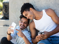 Empowering with PrEP. Source: Adobe Stock; Copyright: Daniel Ernst; URL: https://stock.adobe.com/images/two-latin-american-guys-playing-a-game-with-phone/175694368; License: Licensed by the authors.