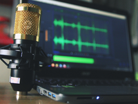 Source: Pexels; Copyright: Seej Nguyen; URL: https://www.pexels.com/photo/gold-condenser-microphone-near-laptop-computer-755416/; License: Public Domain (CC0).