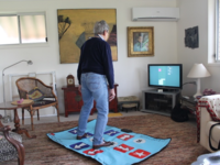 Study participant using Sure Step. Source: Image created by the Authors; Copyright: The Authors; URL: http://aging.jmir.org/2018/2/e11975/; License: Creative Commons Attribution (CC-BY).