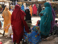 Women in Darfur. Source: COSV/Wikipedia; Copyright: COSV; URL: https://commons.wikimedia.org/wiki/File:COSV_-_Darfur_2008_-_Market.jpg; License: Public Domain (CC0).