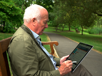 A scene from the Getting Down to Coping promotional film showing a man with prostate cancer using the program. Source: Image created by the Authors; Copyright: University of Surrey; URL: https://www.youtube.com/embed/jZtPzxAU3yI?rel=0; License: Licensed by JMIR.