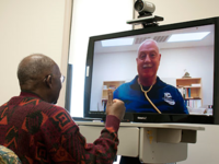 Veteran and provider meet using Clinical Video Telehealth. Source: US Department of Veterans Affairs; Copyright: US Department of Veterans Affairs; URL: https://www.philadelphia.va.gov/PHILADELPHIA/features/Telehealth_The_VA_s_Virtual_Care_System.asp; License: Public Domain (CC0).
