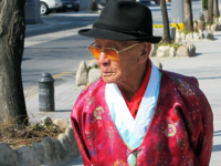 Source: Pixabay; Copyright: Jason Goh; URL: https://pixabay.com/en/korea-street-morning-seoul-old-man-226476/; License: Public Domain (CC0).