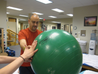 Upper limb strengthening with physioball. Source: Flickr; Copyright: Roger Mommaerts; URL: https://www.flickr.com/photos/rmommaerts/5612291072/in/photostream/; License: Creative Commons Attribution + ShareAlike (CC-BY-SA).