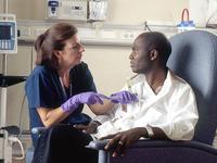 Source: Wikimedia Commons; Copyright: Rhoda Baer; URL: https://commons.wikimedia.org/wiki/File:Nurse_administers_chemotherapy.jpg; License: Public Domain (CC0).