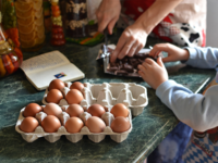 Mom and child baking in kitchen. Source: Pixabay; Copyright: Anna Prosekova; URL: https://pixabay.com/en/food-table-egg-hand-natural-3230799/; License: Public Domain (CC0).