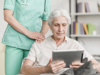 Source: Freepik; Copyright: Freepik; URL: https://www.freepik.com/free-photo/nurse-standing-near-senior-woman-using-digital-tablet_2639966.htm#term=patient%20tablet&page=2&position=36; License: Licensed by JMIR.