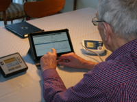 A patient looking at his health data. Source: Image created by the Authors; Copyright: Birthe Dinesen; URL: http://rehab.jmir.org/2018/2/e10758/; License: Creative Commons Attribution (CC-BY).