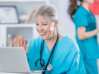 A nurse giving telemedicine advice. Source: iStock by Getty Images; Copyright: Steve Debenport; URL: https://www.istockphoto.com/gb/photo/senior-nurse-waves-while-participating-in-video-conference-gm696021828-128838715?clarity=false; License: Licensed by the authors.