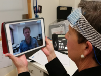 A participant performing a videoconference with the research team while doing in-home transcranial direct current stimulation. Source: Image created by the Authors; Copyright: The Authors; URL: http://www.researchprotocols.org/2018/10/e10848/; License: Creative Commons Attribution (CC-BY).