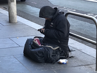 A homeless person using his mobile phone in the street. Source: The Authors; Copyright: Fran Calvo; URL: http://mental.jmir.org/2018/4/e59/; License: Licensed by JMIR.