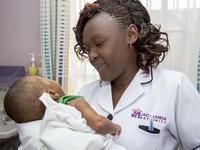 Jacaranda nurse and newborn. Source: Jacaranda Health; Copyright: Jacaranda Health; URL: https://jacarandahealth.org/blog/page/3/; License: Licensed by JMIR.