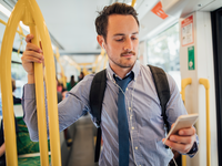Source: iStock by Getty Images; Copyright: DGLimages; URL: https://www.istockphoto.com/photo/businessman-commuting-by-tram-in-melbourne-gm872837436-243783918; License: Licensed by the authors.
