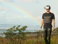 Man wearing a virtual reality head-mounted device while walking in nature. Source: Pexels; Copyright: Bradley Hook; URL: https://www.pexels.com/photo/sea-landscape-nature-sky-123318/; License: Licensed by the authors.
