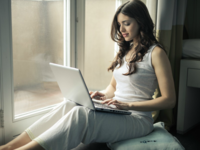 Patient accessing their medical record online. Source: Pexels; Copyright: Bruce Mars; URL: https://www.pexels.com/photo/woman-wearing-tank-top-sitting-by-the-window-920381/; License: Licensed by JMIR.